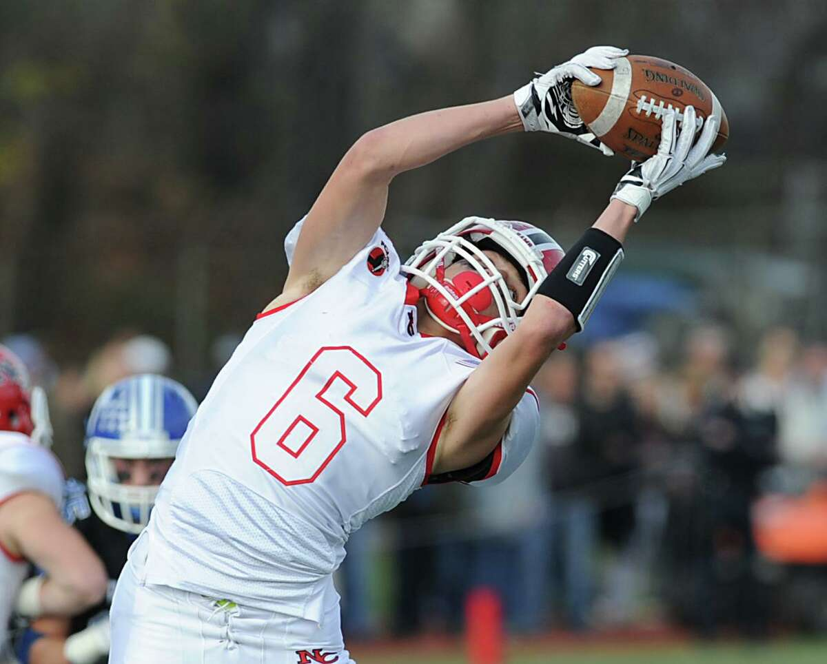 Andrew DeFranco (6) makes a catch while playing for New Canaan in the 2015 FCIAC championship game. DeFranco is now a senior wide receiver for the Colby College football team.