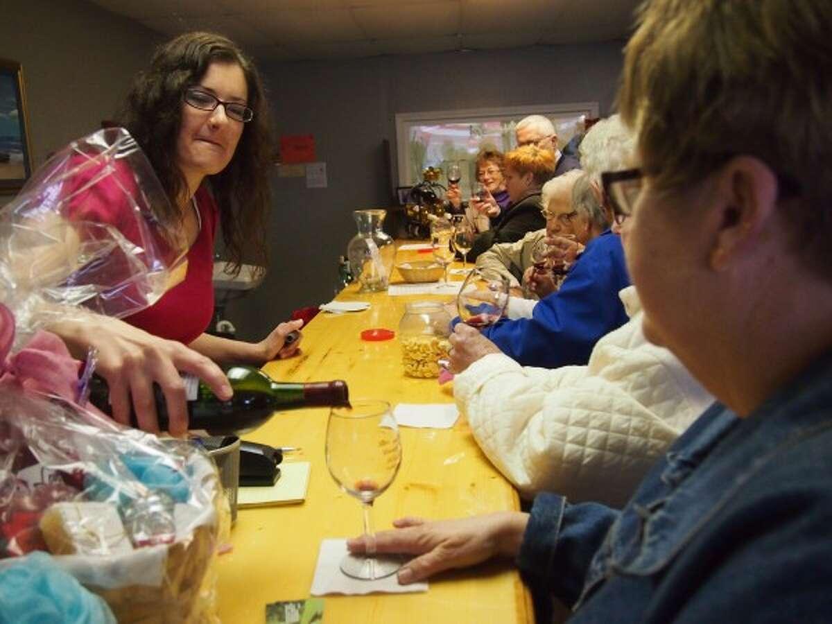 Seniors sample wine at Love Wines in Ludington during a senior center Mystery Trip on Thursday.(Courtesy photo/Jeanne Barber)