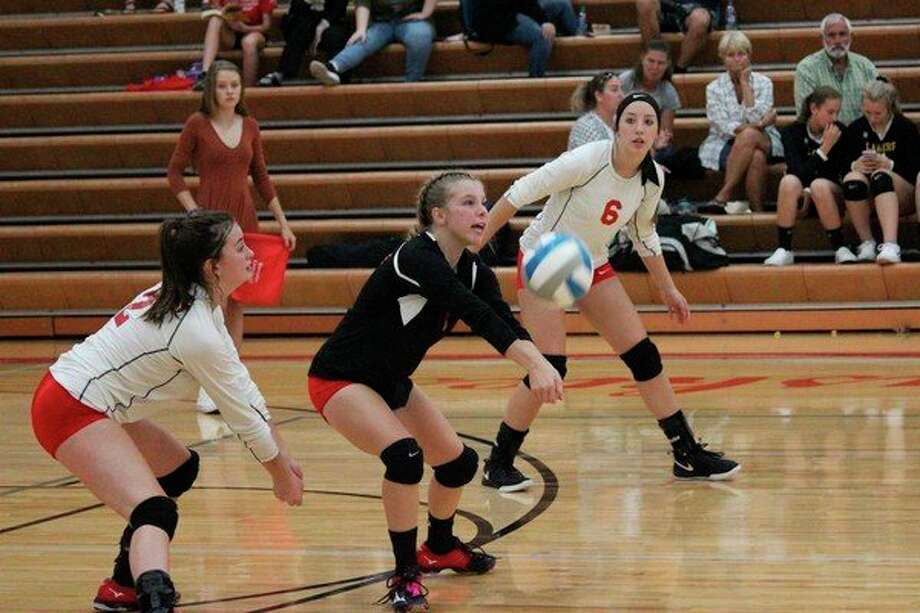 Ryleigh Frisbie fields a serve during the Huskies victory over Glen Lake. (Photo/Robert Myers)