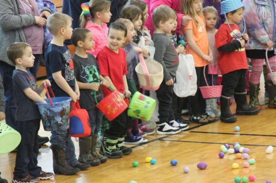 Children eagerly await the beginning of the Jaycees Easter Egg Hunt on Saturday at the Armory Youth Project. (Michelle Graves/News Advocate)