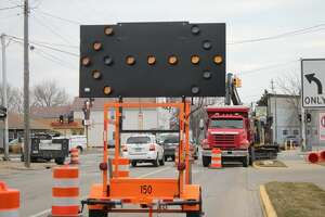 Orange barrels and a traffic sign have been posted along First Street toward Cypress Street, running along Cypress Street, to manage traffic. This signal indicates the right turn lane is closed and tells drivers to move into the left turn lane, however drivers may still turn right at the intersection. (Sean Bradley/News Advocate)