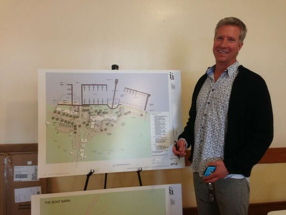 Portage Point Inn owner Bob Gezon poses with a site plan for the resort at a public session held at the Farr Center in Onekama on Monday. (Justine McGuire/News Advocate)