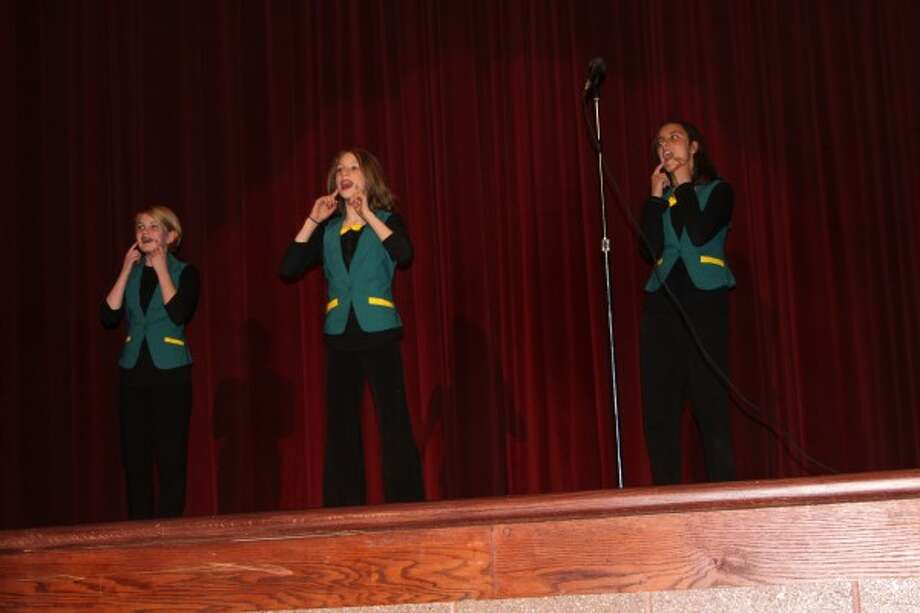 Seventh graders Lilly Schafer, Haylee Schafer and Ava Thuemmel sang an a cappella song on Tuesday during theManistee Middle/High Schoolannual talent show to benefit Relay for Life. (Michelle Graves/News Advocate)