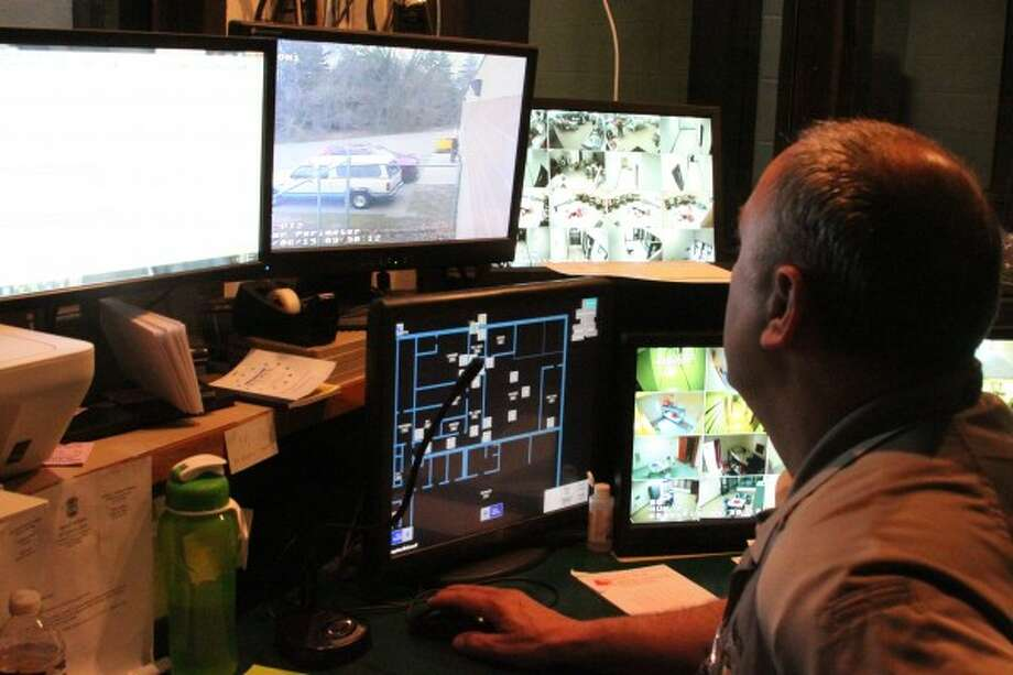 Monitoring the many screens and security cameras is one of the many duties of Eric Sovereign, a correctional officer at the Manistee County Jail, which has 68 cells. Other duties he and other correctional officers do include keeping a record of every action that takes place at the jail, including who is checked in and out, when meals are distributed to inmates and many other actions. (Sean Bradley/News Advocate)