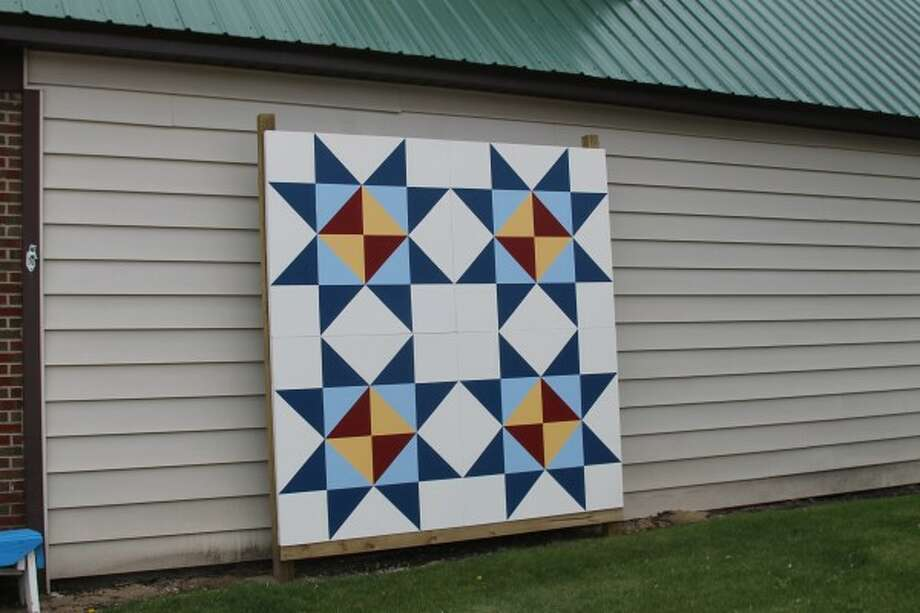 The Kaleva Art Gallery's quilt square is displayed next to the building. It is the first in the ACA of Manistee County quilt trail. The pattern was chosen for its beauty, simplicity and colors. (Justine McGuire/News Advocate)