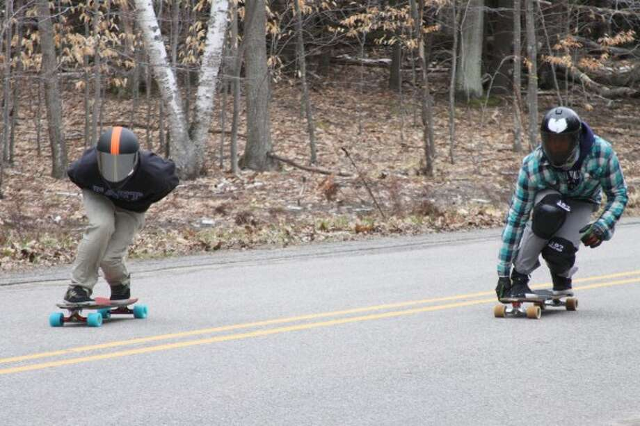 Longboarders make his way down the .94 mile hill on Smith Road in Onekama during the 2014 Rage at the Ridge race event. (File photo)