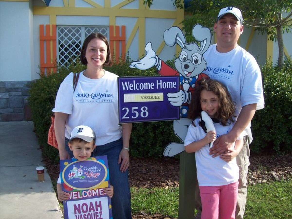 Noah Vasquez, who started a battle with cancer before his 1st birthday, stands outside a villa in Florida with his family -- mom Jill Vasquez, dad Roger Vasquez and sister Olivia Vasquez -- during his Make-a-Wish trip that helped celebrate his 4th birthday. (courtesy photo)
