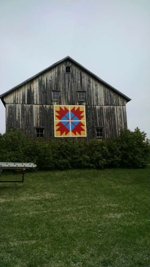 A new quilt square hangs on the side of the 1900s Barn at the Marilla Museum and Pioneer Place. It's part of the Manistee Arts and Culture Alliance quilt trail. (Courtesy photo)
