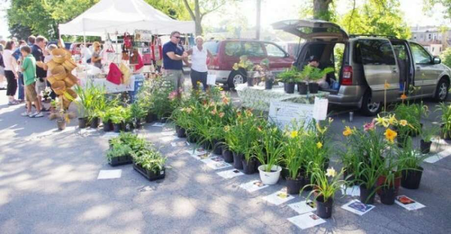 Flowers are sold at the Manistee Farmers Market, located on the corner of Memorial Drive and Washington Street in Manistee. (News Advocate File Photo)