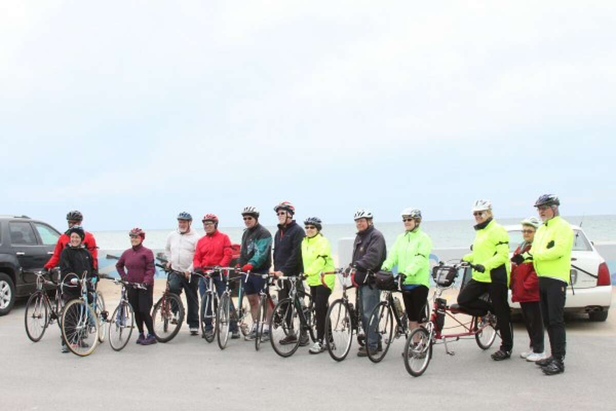 About 20 people took part in Manistee's first-ever Ride of Silence Wednesday. The event was organized by Ed Jones (middle), a Manistee resident and member of the City of Manistee Non-motorized Transportation Committee. Jones has participated in the event in other cities around the country. More riders who participated are not pictured as they showed up after the photo was taken. (Sean Bradley/News Advocate)