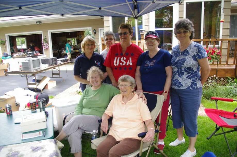 Members of the Kaleva Crusaders and Friends Relay for Life team pose together at one of the team's annual yard sales. (Courtesy photo)