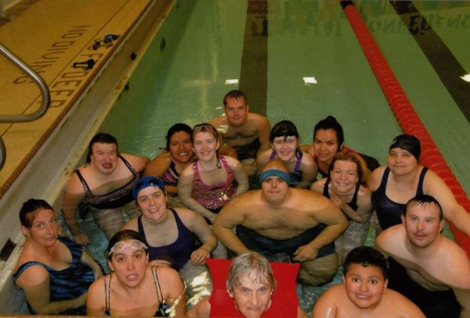 Members of the aquatic team included Marlene Shively, Hadley Payne, Donna Nichol, Anthony Zapata, Beth Shangle, Erik Boerema, Liz Heidl, Anna Marr, Andrea Hummer, Lupe Carrabuias, Aja and Katie Shilander, Josh Bidelman and Logan Grabowski. Also pictured is Tina Carrabuias, whom did not take part in competition. (Courtesy Photo)