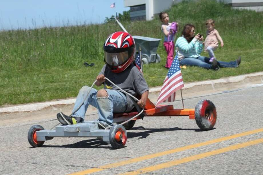 Liam Edmonson races to the finish line during the Cub Scouts Pack No. 269 first-ever Cub Mobile on Saturday. The event, similar to a soap box derby, saw racers travel down the hill on Washington Street, near the water tower. (Photos by Michelle Graves/News Advocate)