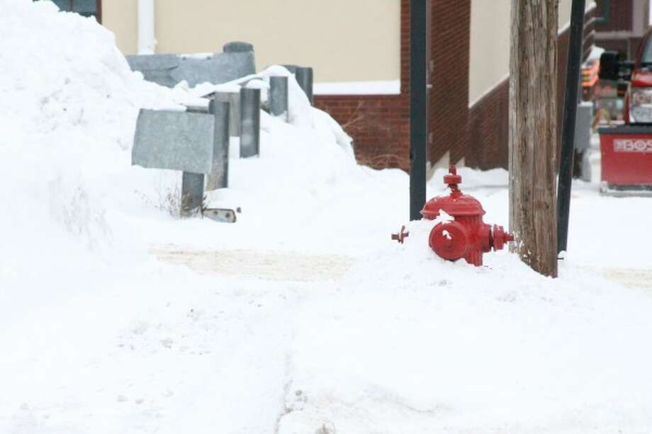The City of Manistee Fire Department has been clearing snow away from fire hydrants at a rate of about six a day. Residents with fire hydrants near their homes can keep them clear by removing snow and ice, clearing a wide perimeter of about 3 feet on each side of the hydrant and clearing a path from the hydrant to the street. (Sean Bradley/News Advocate)