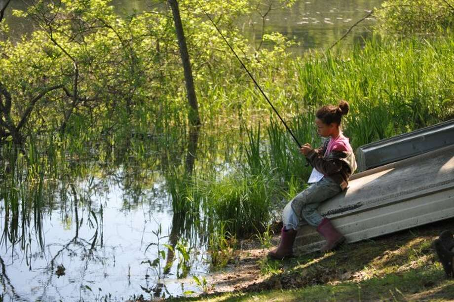 A participant in the 2014 Memorial Bobbie Brown Fishing Derby takes a leisurely approach by finding a seat on a row boat. (File photo)