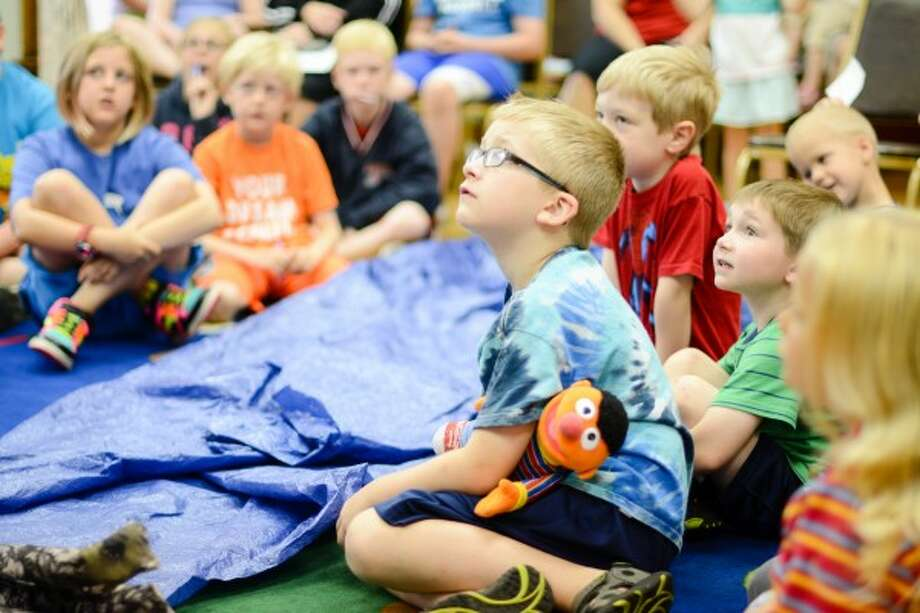 About 30 children at the Manistee County Library Tuesday morning learn how beavers create dams. (David Navadeh/News Advocate)