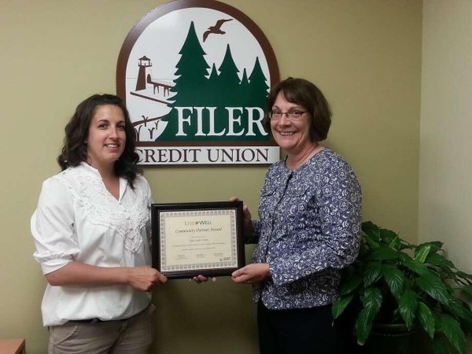 Kaci Kamaloski (left) and Patty Preuss accept the Live Well Community Partner Award for Filer Credit Union. (Courtesy Photo)