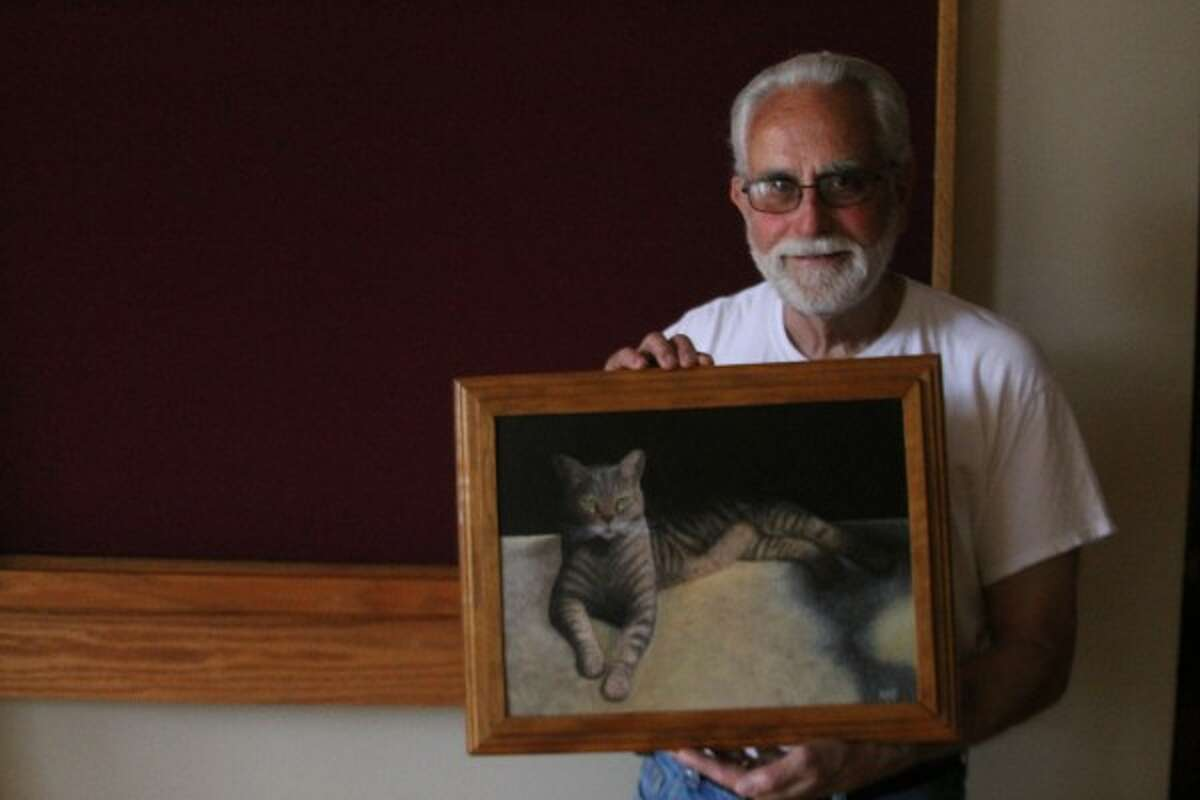Manistee resident Harry Dutton will be showcasing his artwork, including his painting of a picture of his cat Shadows, in the Manistee Art Institute's