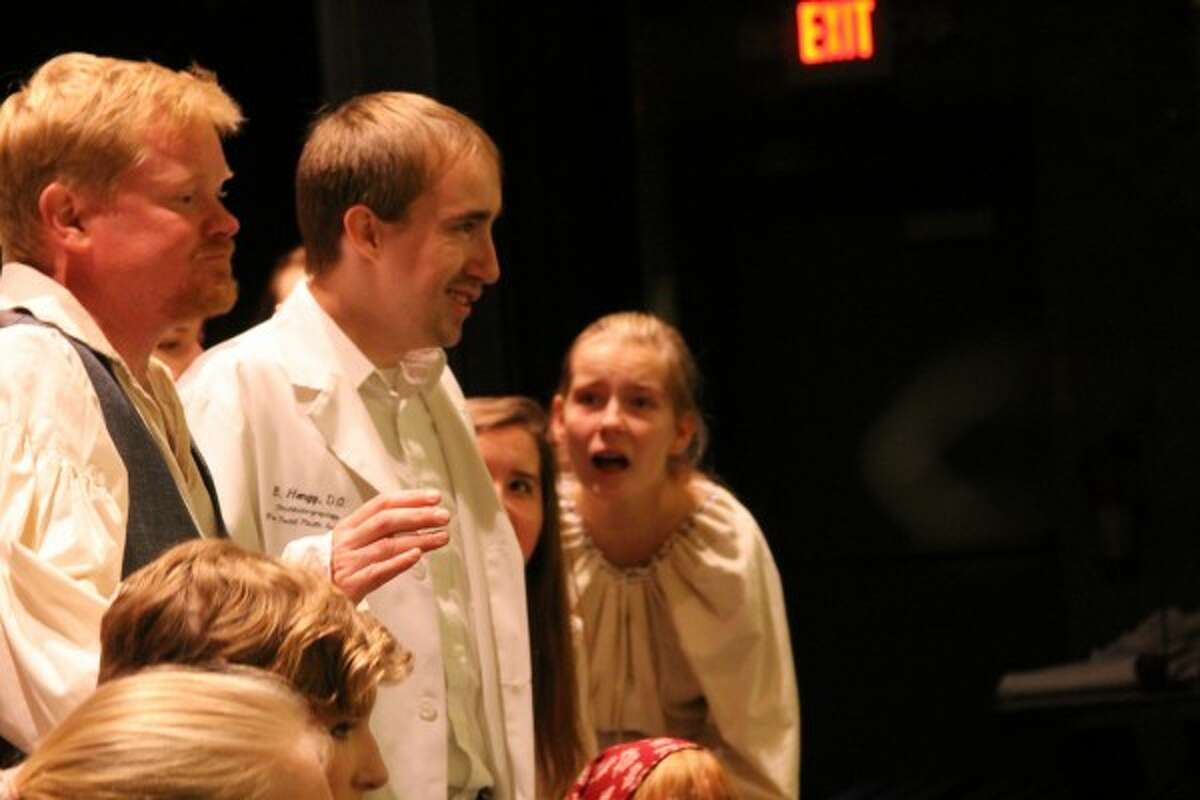 The young Dr. Frankenstein, played by Sean Gilbert, is surrounded by other cast members during the musical's opening number,