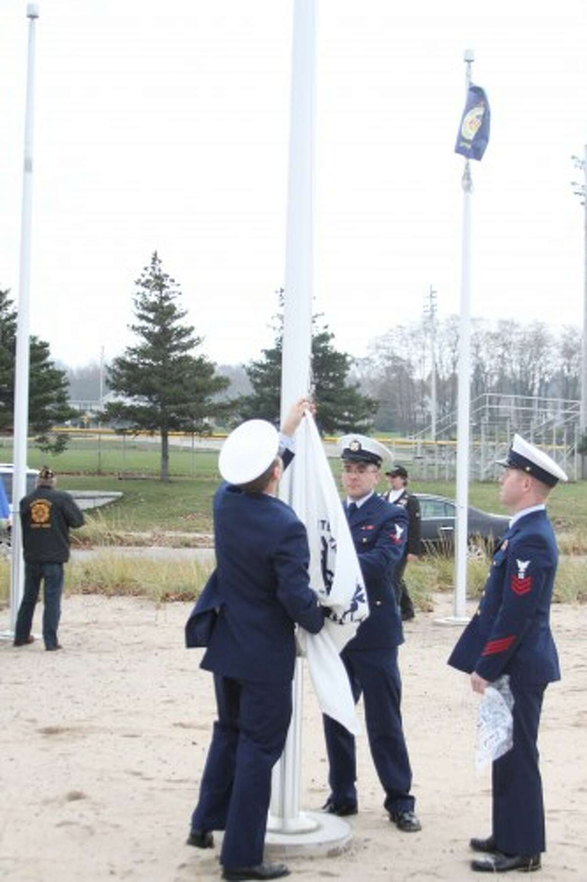 Members of the U.S. Coast Guard lowered their respective flag during a ceremony Wednesday at the First Street beach roundabout. Flags of the other respective branches of the military were also lowered. The American and POW flags at the First Street beach Lions pavilion were lowered in a ceremony as well. All of the flags will be stored at the VFW Walsh Post No. 4499 until the flags are raised again in the spring. (Sean Bradley/News Advocate)