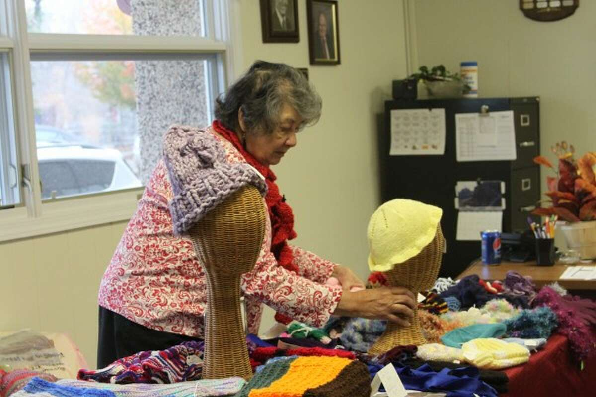 Maxine Pettinger, of Manistee, sold scarves, hats and afghans at the Manistee Senior Center craft show on Saturday. (Michelle Graves/News Advocate)