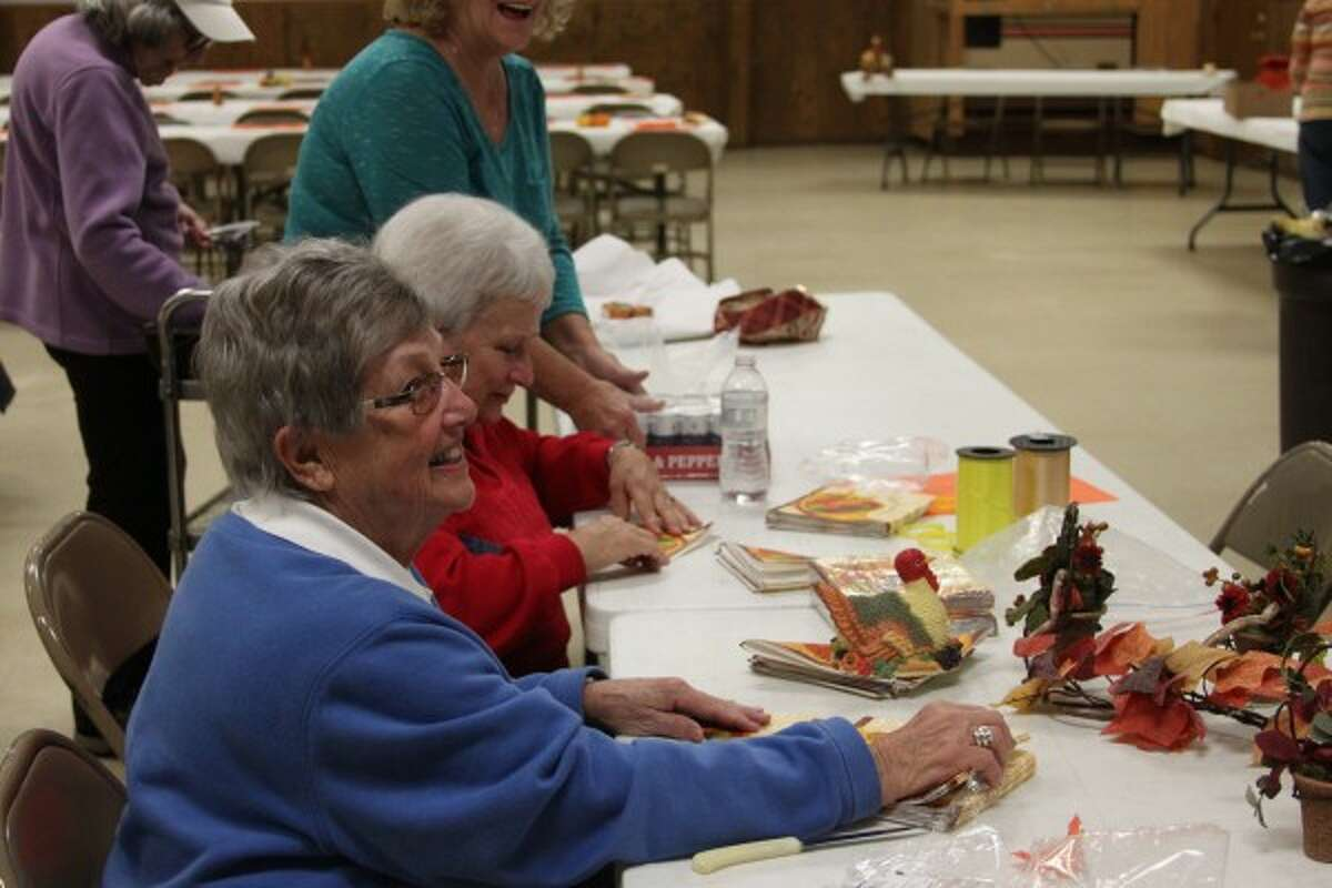 Manistee resident Nancy LaPorte volunteered her time before the annual Bettie Naffie Memorial Dinner on Thanksgiving last week to help prepare the tables for the dinner service, which served many local residents. (Sean Bradley/News Advocate)