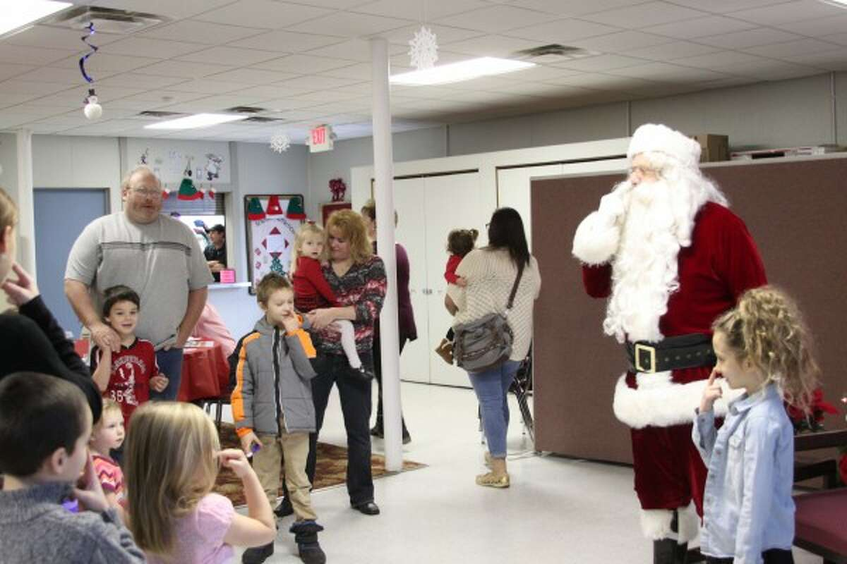 Children who met Santa on Saturday at the Manistee County Senior Center talked to him and played games such as