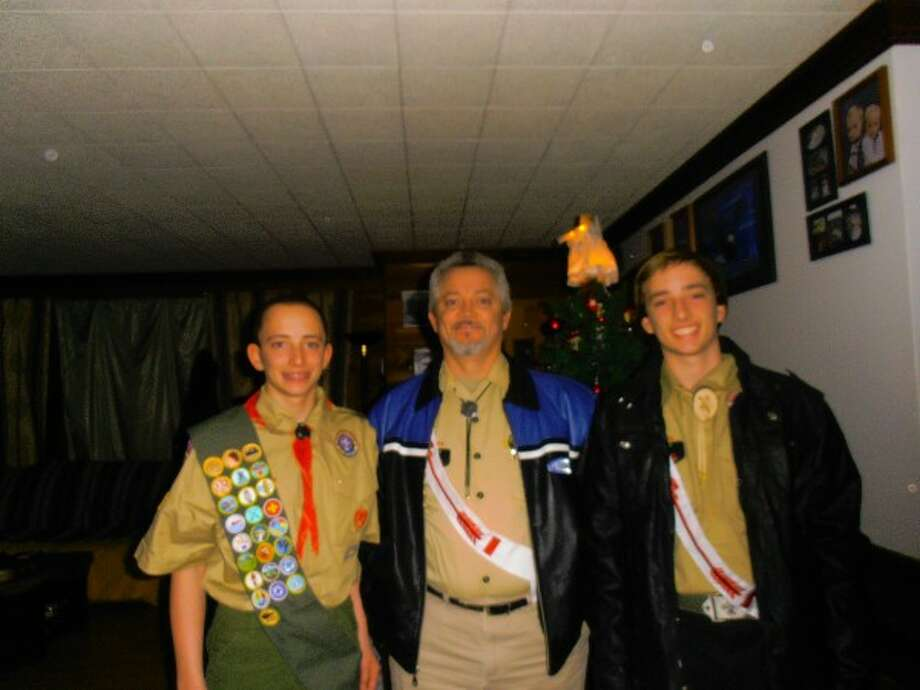 James Holden (middle), of Wellston, with his sons James (left) and Jesse (right) in November 2012. Holden started in Boy Scout Troop No. 61 as a den leader, then was cub master for four years followed by scoutmaster for five years. Stepping down recently, Holden now serves on the troop's committee, which oversees everything the scouts do. (Courtesy Photo/News Advocate)