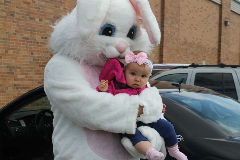 The playground at Jefferson Elementary was popping with pastel colors Saturday afternoon as plastic eggs were strewn as far as wide youthful eyes could see. Ten-month-old Kendall Szpliet got to meet the Easter Bunny. (Dylan Savela/News Advocate)
