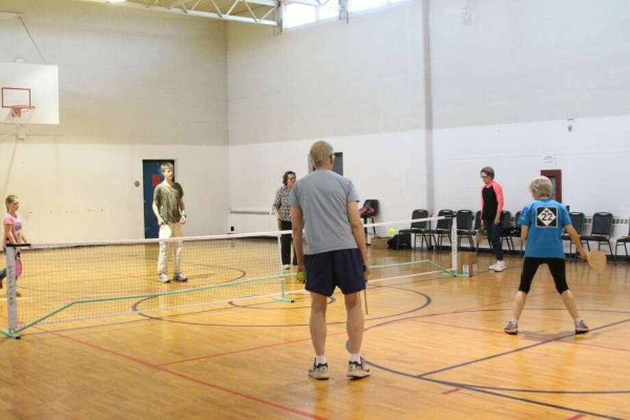 At least four new Pickleball players visited on Friday at the Pleasant Valley Community Center (PVCC). They were taught the game by PVCC board president Sue Walker, as were others who came for lessons all last week. (Sean Bradley/News Advocate)