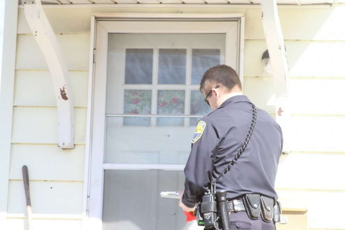 Manistee Police officer John Fraass has been working overtime recently to issue blight letters of intent to city residents. In a two-day period last week, he issued 30 letters to as many residents. Residents can face consequences such as fines to the city if they do not comply with the letter's demands. (Sean Bradley/News Advocate)