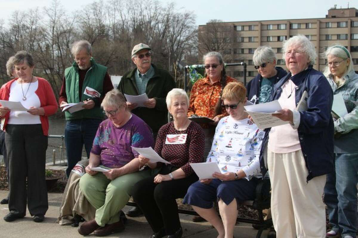 Members of the Manistee Peace Group gathered on Wednesday for their annual Earth Day celebration. The group read poetry, recited famous quotes about the Earth and sang songs. (Dylan Savela/News Advocate)