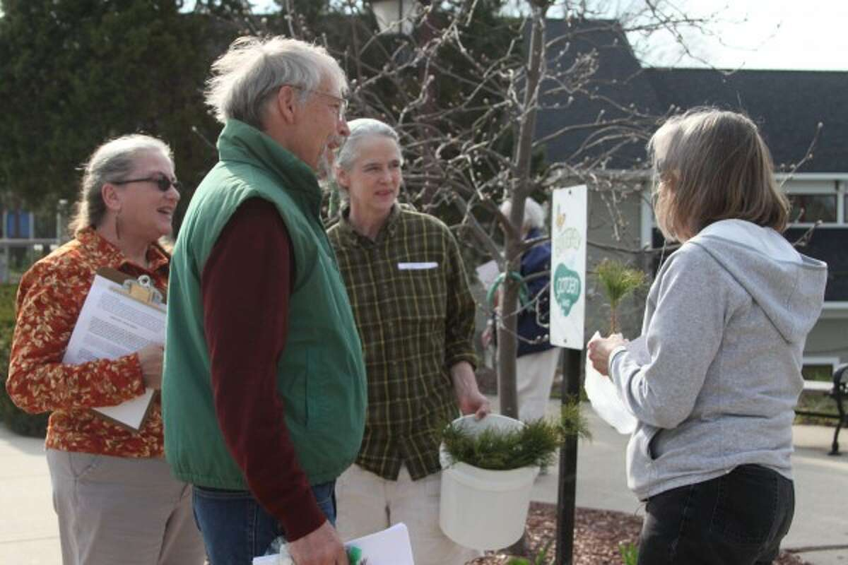 The Manistee Peace Group gave trees to attendees on Wednesday during their annual Earth Day celebration. (Dylan Savela/News Advocate)