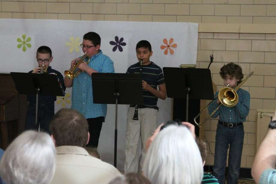 Gabe and Miles Bednarczyk, Kyle Pierce and Nick Spraguean put on an ensemble performance at Trinity Lutheran School on Saturday during the 35th annual Expression Session.