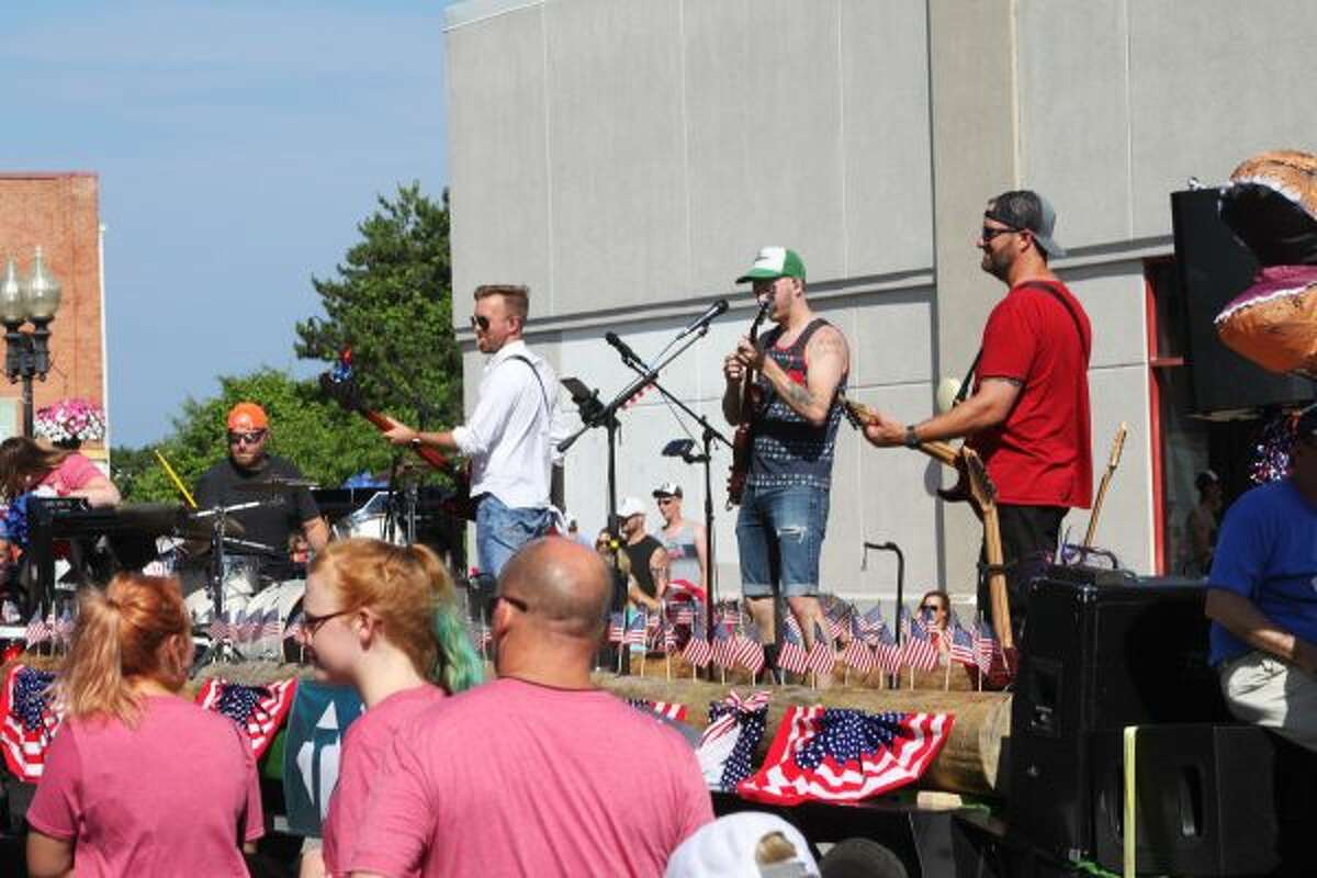 The Tabernacle Manistee float had a band that played energetic rock songs for the parade crowd. (Ashlyn Korienek/News Advocate)