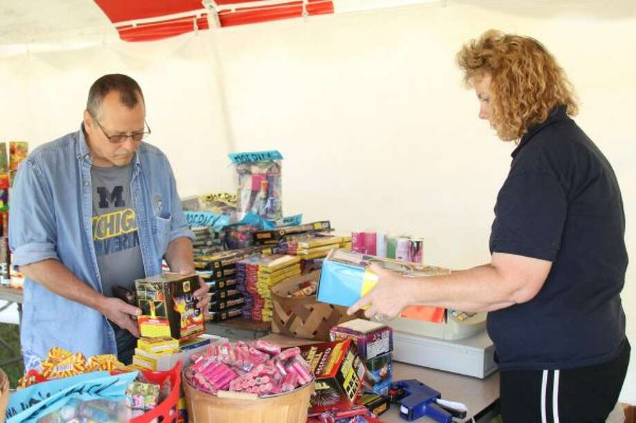 """Manistee resident Rick Janowiak purchased mortar fireworks and sparklers, among other things, Monday from Jackie and Anthony Jewell's fireworks stand for Fourth of July activities with his children. """"If there's kids around, the kids are going to be at least 50 feet and beyond, especially with these things (the mortars),"""" Janowiak said. """"You don't know what they're going to do."""" (Sean Bradley/News Advocate)"""