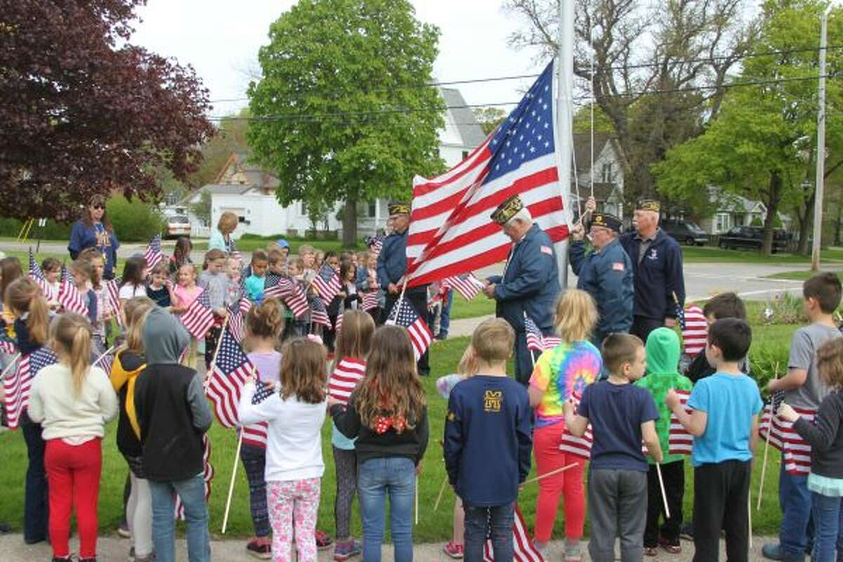 Members of the Manistee Veterans of Foreign Wars Walsh Post No. 4499 put on a special program for the students at Jefferson Elementary School on Friday for Memorial Day. Post commander Don Vadeboncouer told the students about what the parts of the flag represent and the meaning of the pledge of Allegiance. (Ken Grabowski/News Advocate)