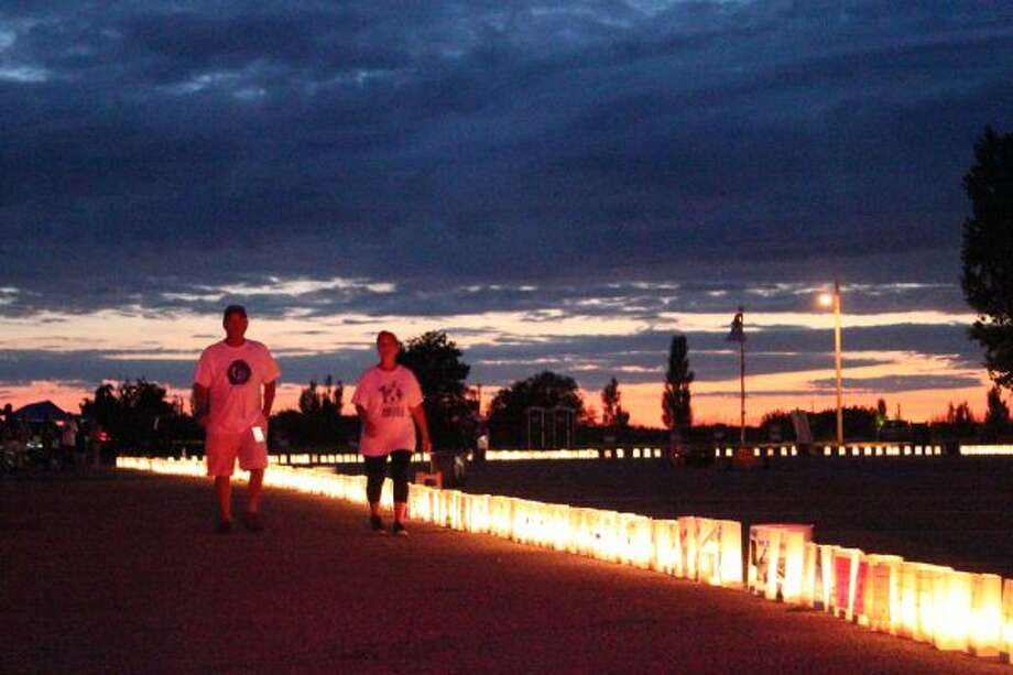 As the sun set on Lake Michigan, those lost were honored with Relay for Life's luminary ceremony on Saturday. (Dylan Savela/News Advocate)