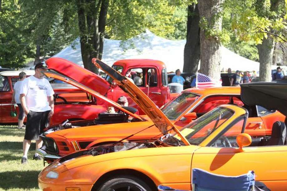 The car show in the Onekama village park featured dozens of muscle and classic vehicles. (Sean Bradley/News Advocate)