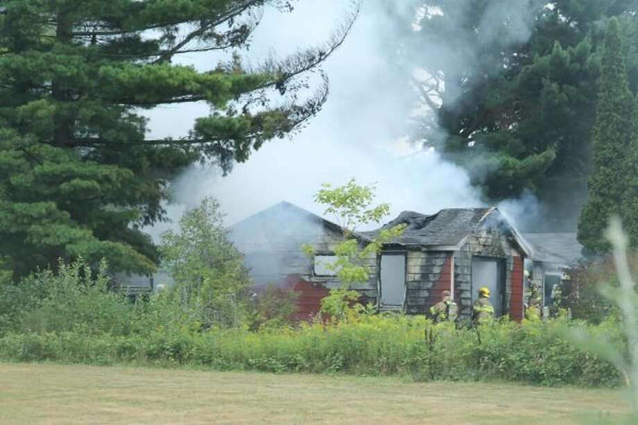 An Onekama Township woman was killed in a fire Friday at a home on the 5000 block of Eight Mile Road in Onekama.