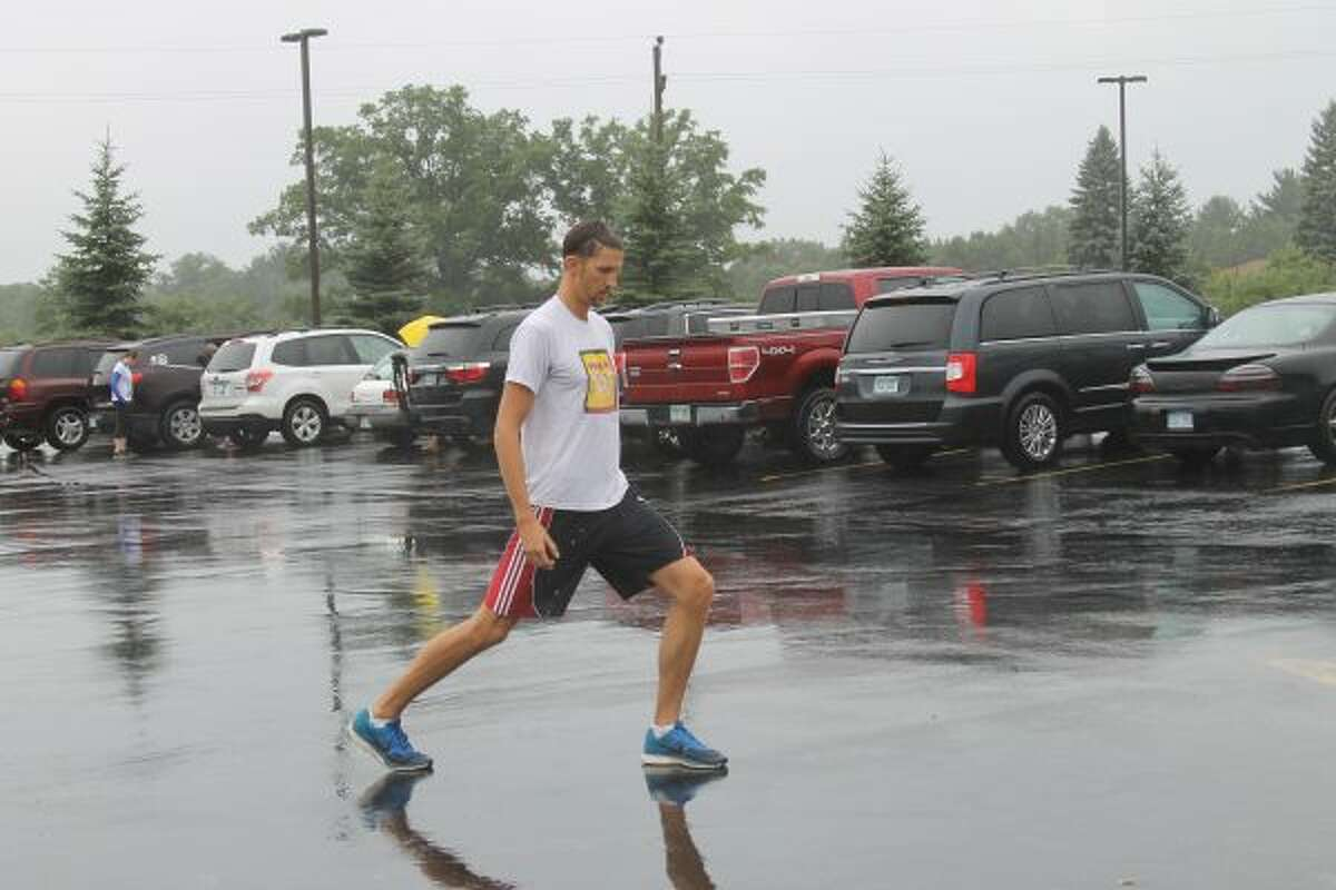 Ryan Borck does lunges on Saturday in the Filer Credit Union parking lot in preparation for the Filer Credit Union/PCA Superhero 5K Walk Run.