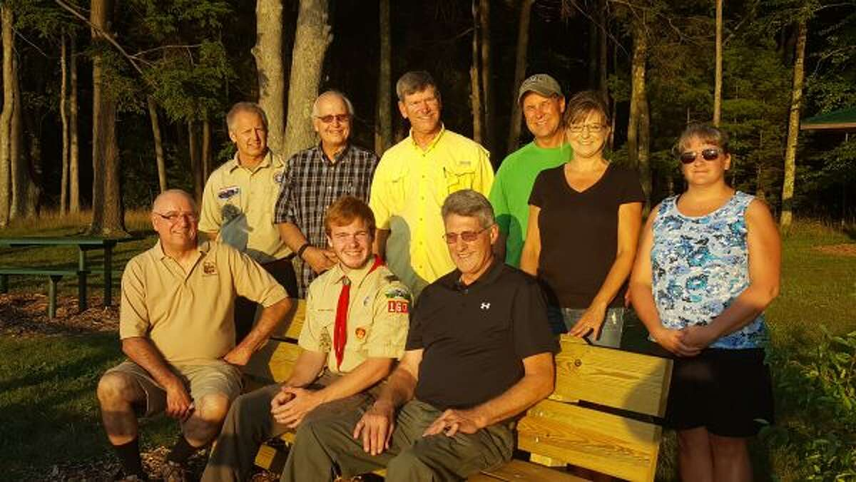 Jarrod Cameron (center) sits along side Filer Township supervisor Terry Walker on Tuesday evening after a board of review officially designated Cameron an Eagle Scout. (Courtesy Photo)