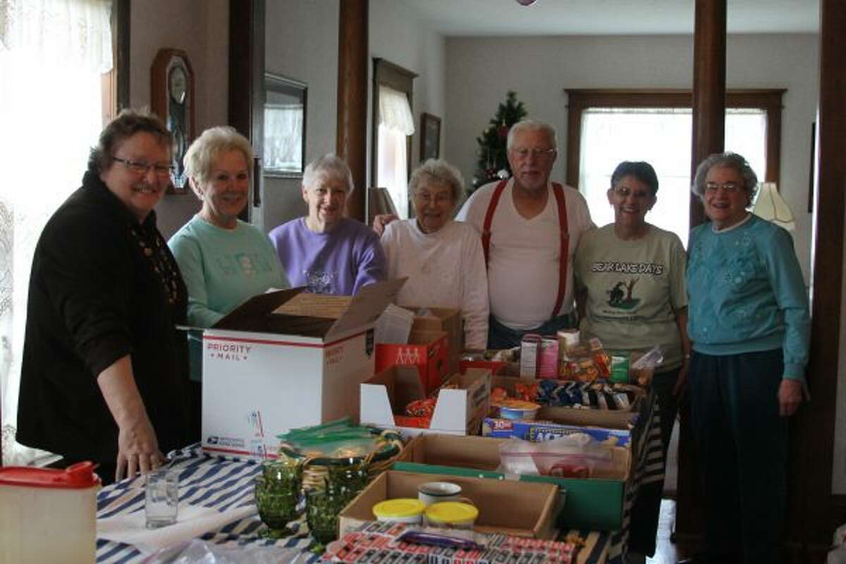 Volunteers for the Care Packages for Troops effort gathered last year to pack and send out care packages around the world. (File Photo)