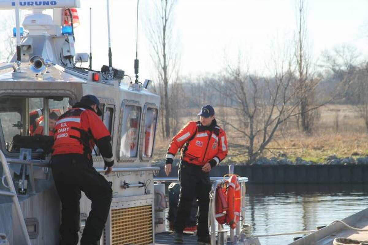 The U.S. Coast Guard Manistee and City of Manistee Fire Department take part in a training event, which focused on saving the life of a 68 year old man. (Ashlyn Korienek/News Advocate)