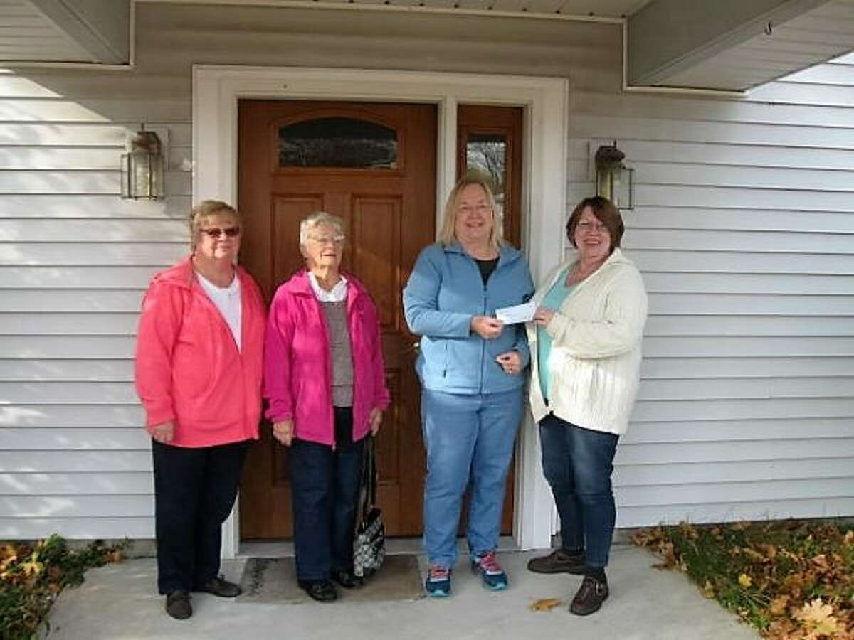 Nancy J. Jans, of Custom-n-Classics Car Club of Northwest Michigan, presents a check to Linda Hatton, of CHOICES of Manistee. Pictured (from left to right) are Linda Downey, Hazel Slonecki, Hatton and Jans. (Courtesy photo)