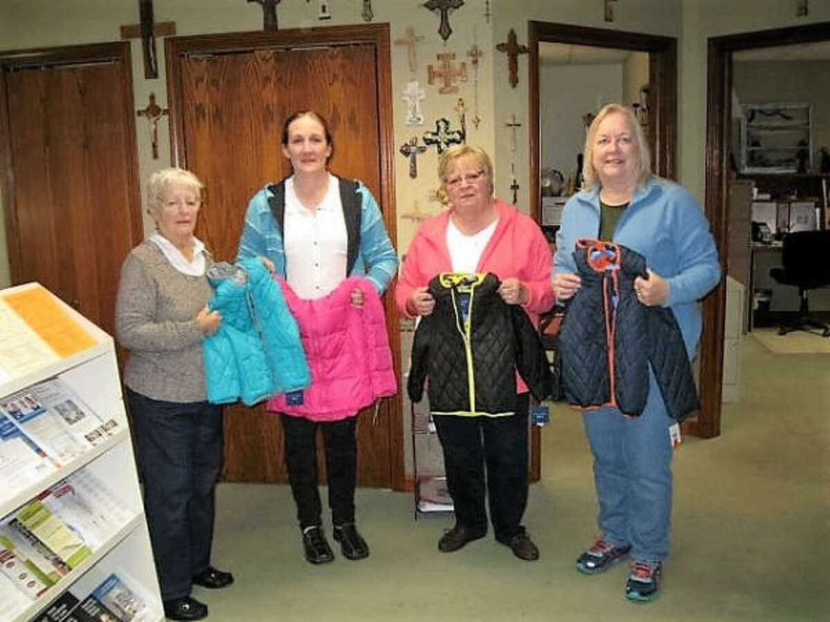 (From left) Hazel Slonecki, Shari O'Neal, Linda Downey and Nancy J. Jans hold brand new children's jackets that were donated by the Customs-n-Classics Car Club for needy children this winter. (Courtesy photo)