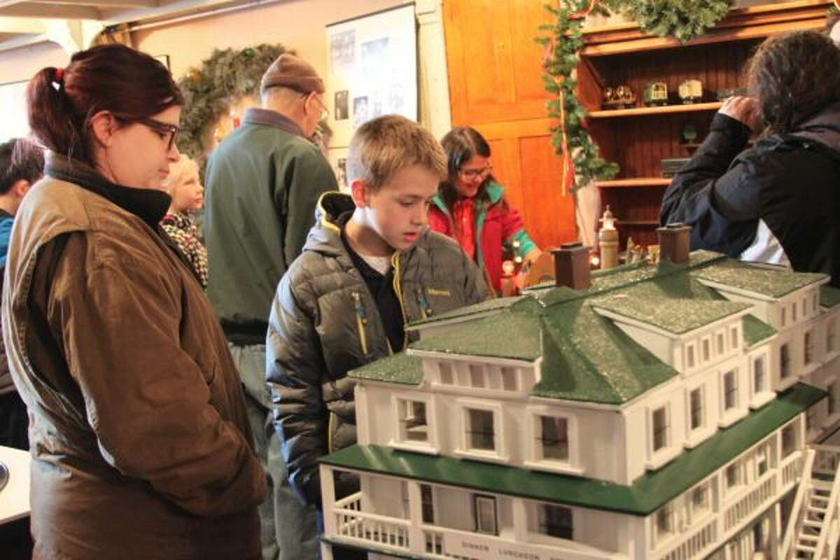 Matthew Tomey, a fourth grader at MCC, looks at a model during his class visit to the history museum on Tuesday. (Michelle Graves/News Advocate)