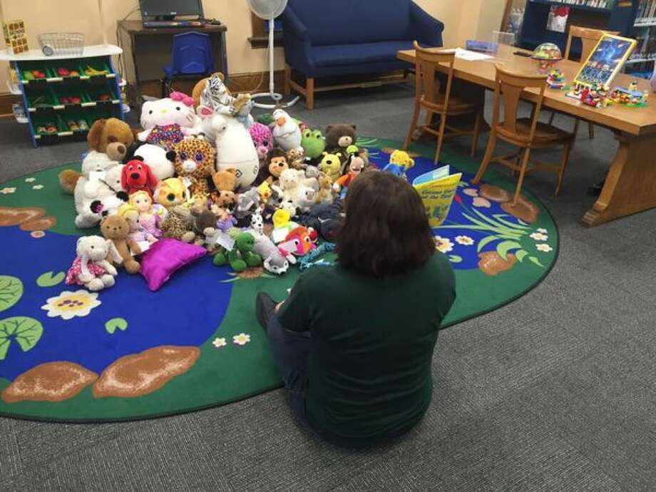 During the Stuffed Animal Sleepover on Friday night, stories were read to the stuffed animals. Almost 60 children dropped off their stuffed animals for the event. (Courtesy photos)