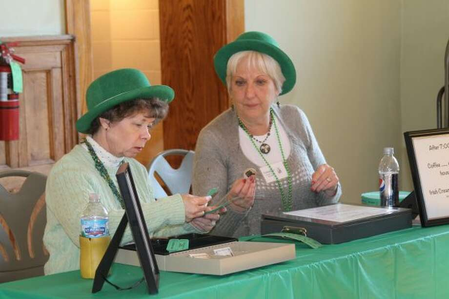 Bonnie Barker (left) and Rose Fosdick sell food and drink tickets on Thursday during Irish Night at the Ramsdell Regional Center for the Arts. (Michelle Graves/News Advocate)