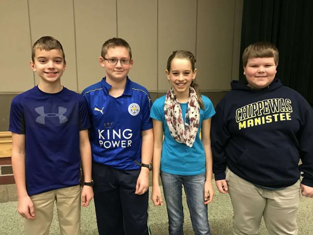 Kennedy Elementary's Spott's Splendid Smarties -- (from left) Luke Smith, Will Somsel, Ceci Postma, Kaleb Shoemate -- won first place in the Manistee County Quiz Bowl competition. (Courtesy photos)